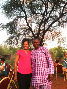 Young Global Leaders Teresa Kennedy and Akinwale Ojomo under the Tree where the Royal Bafokeng Nation Community Leaders Meet
