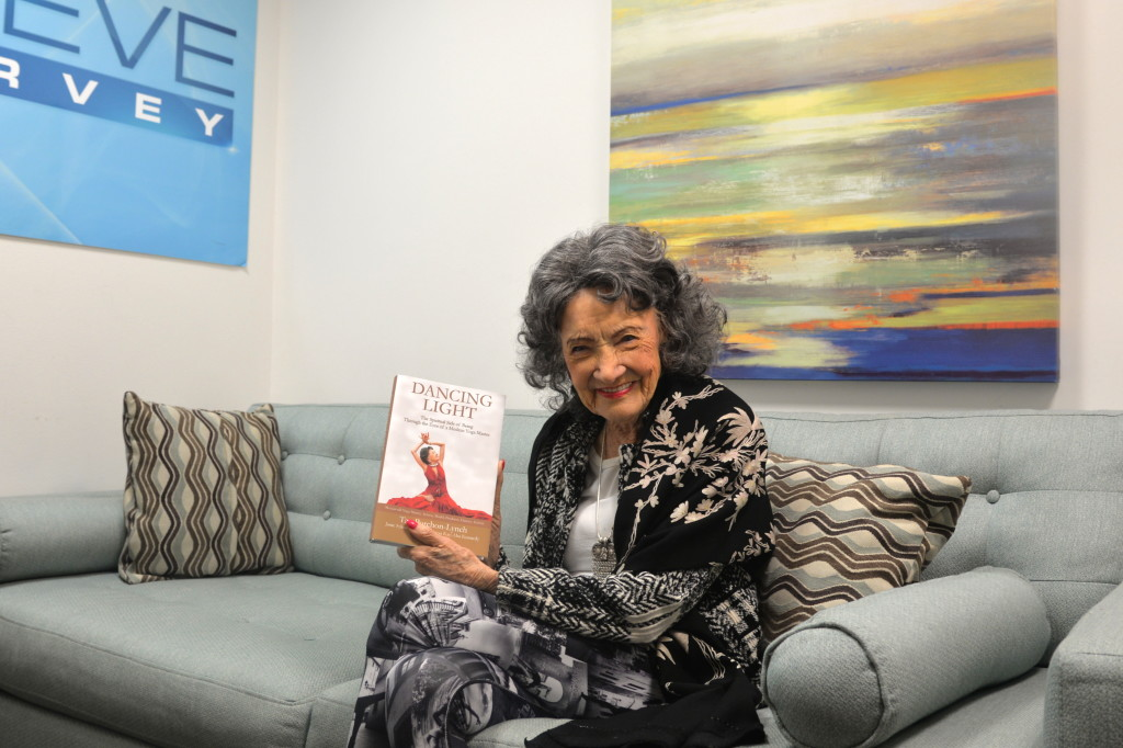 96-year-old Tao Porchon-Lynch holding her new book, Dancing Light, at the Steve Harvey Show green room in Chicago