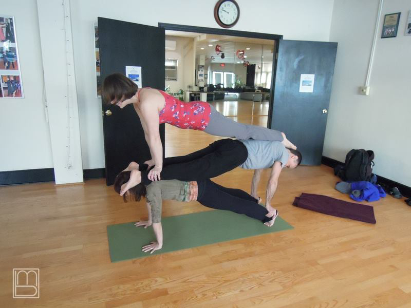 AcroYoga Class with Three Stacked Planks