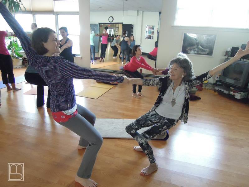 96-year-old Yoga Master Tao Porchon-Lynch and Chris Loebsack in an AcroYoga Class
