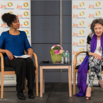 Teresa Kay-Aba Kennedy moderating an event with 96-year-old Yoga Master Tao Porchon-Lynch at the JCC Mid-Westchester on April 27, 2015