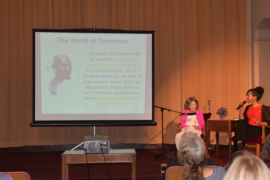 97-year-old yoga master Tao Porchon-Lynch and empowerment expert Teresa Kay-Aba Kennedy leading The Gandhi Effect workshop in Kansas City