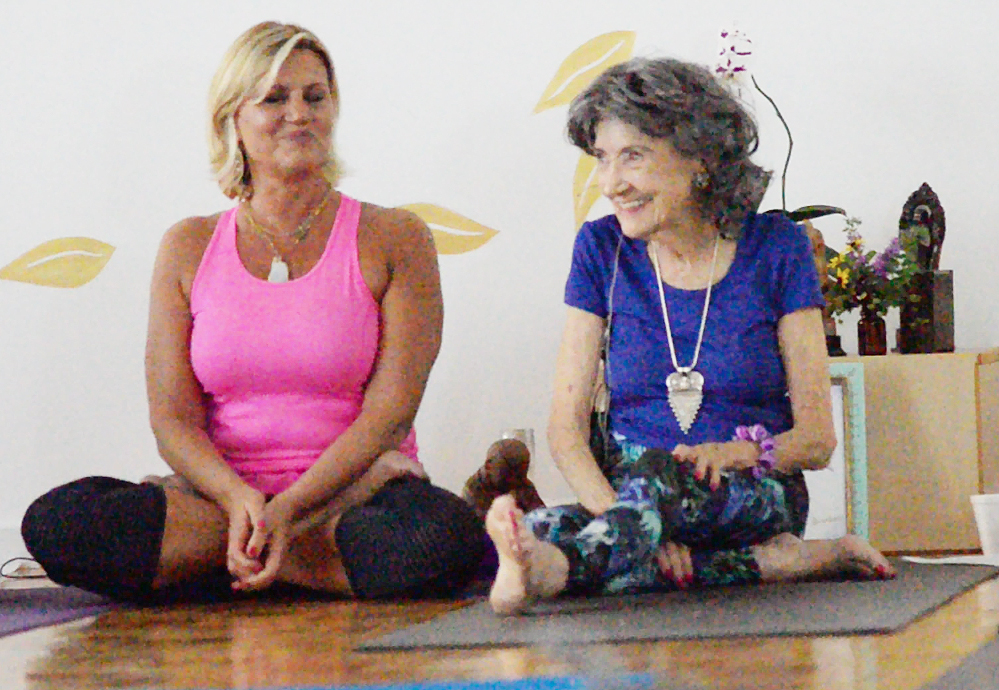 Gretchen Robinson with 97-year-old yoga master Tao Porchon-Lynch at Mark Blanchard's Yoga in Kansas City
