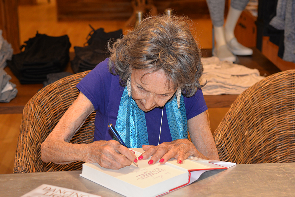 97-year-old yoga master Tao Porchon-Lynch signing her autobiography at Athleta event in Scarsdale, September 17, 2015