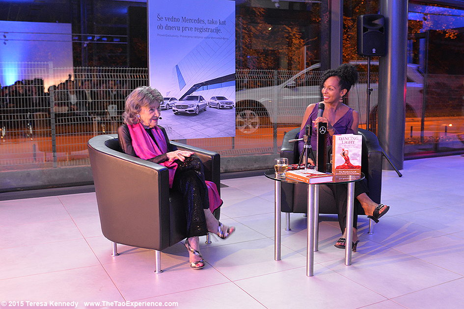 97-year-old yoga master Tao Porchon-Lynch and Teresa Kay-Aba Kennedy presenting at Conversation with a Master event hosted by the Young Executives Society (YES) and Mercedes in Slovenia, October 8, 2015